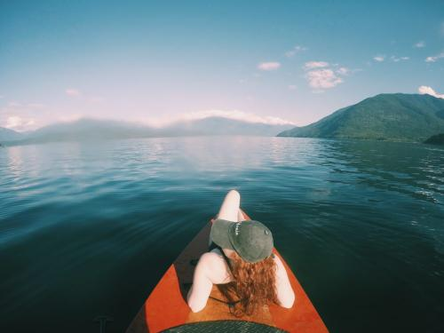 D'Arcy Green enjoying a kayak ride in Queen's Bay, British Columbia